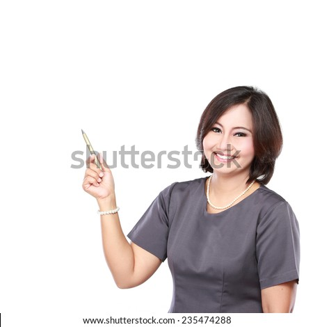portrait of mature business woman showing blank area - stock photo