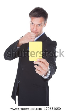 Portrait Of Mature Businessman Showing Yellow Card Over White Background - stock photo