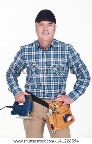 portrait of mature carpenter - stock photo