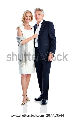Portrait of mature couple in party wear standing together on white background