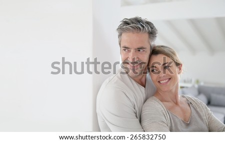 Portrait of mature couple looking toward the future - stock photo