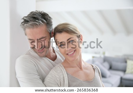 Portrait of mature couple relaxing at home - stock photo