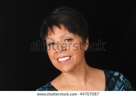 portrait of mature lady against black background - stock photo