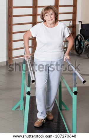 Portrait of mature man having ambulatory therapy. - stock photo
