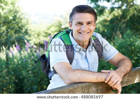 Portrait Of Mature Man Hiking In Countryside