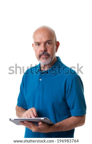 Portrait of mature man in blue polo shirt using electronic tablet isolated on white - stock photo