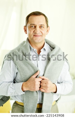 Portrait of mature man in casual looking at camera in isolation - stock photo