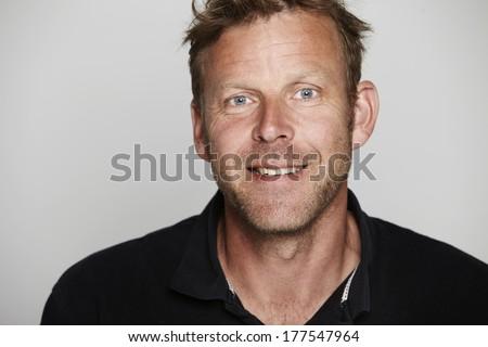 Portrait of mature man in studio, smiling - stock photo