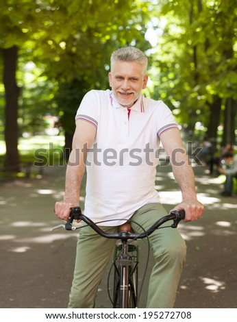 Portrait of mature man on the bike