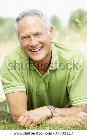 Portrait of mature man relaxing in countryside - stock photo