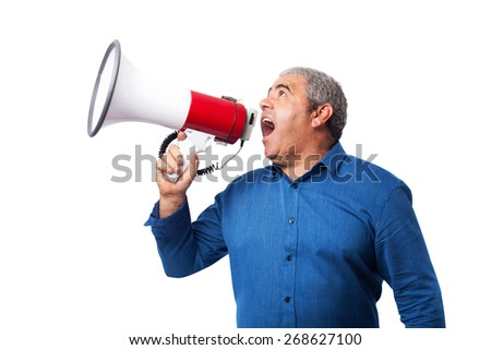 portrait of mature man shouting with the megaphone - stock photo