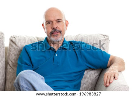 Portrait of mature man sitting on the couch isolated on white