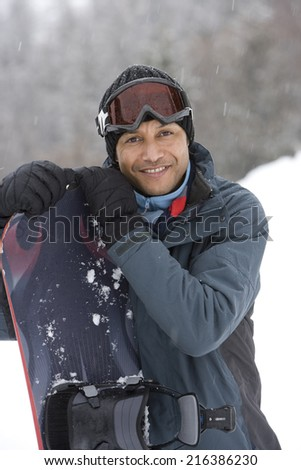 Portrait of mature man with snowboard