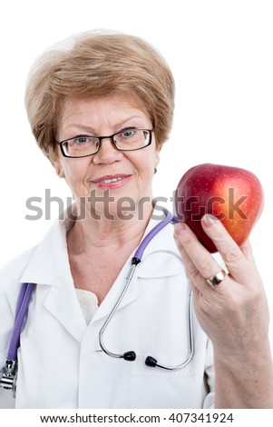 Portrait of mature medical professional with big red apple in hand, isolated on white background - stock photo