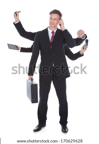 Portrait Of Mature Multitasking Businessman Isolated Over White Background - stock photo