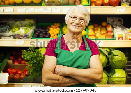 Portrait of mature store worker - stock photo