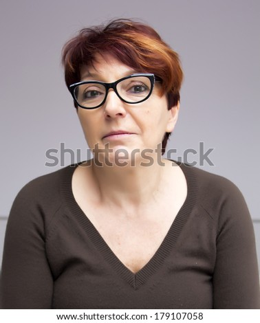portrait of mature woman in black glasses