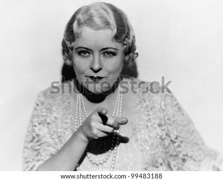 Portrait of mature woman pointing finger - stock photo