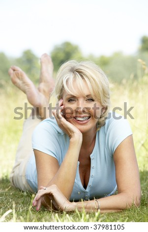 Portrait of mature woman sitting in countryside