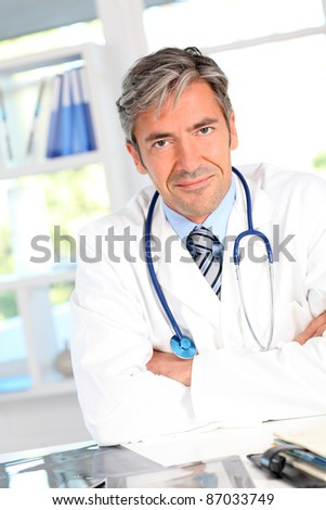 Portrait of medical people using electronic tablet - stock photo