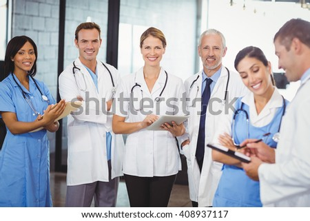 Portrait of medical team standing with file and clipboard in hospital