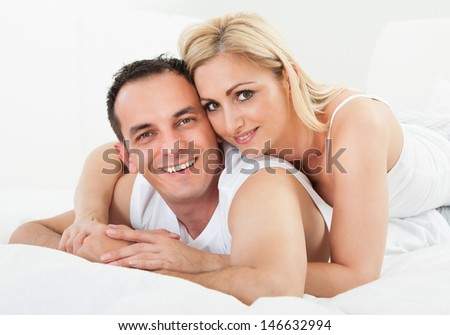 Portrait Of Mid-adult Happy Couple Smiling Together - stock photo