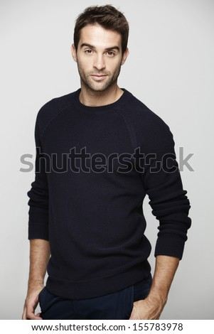 Portrait of mid adult man against grey background