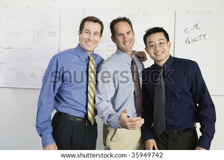Portrait of mid adult men standing together. - stock photo