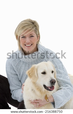 Portrait of mid adult woman with dog, cut out - stock photo