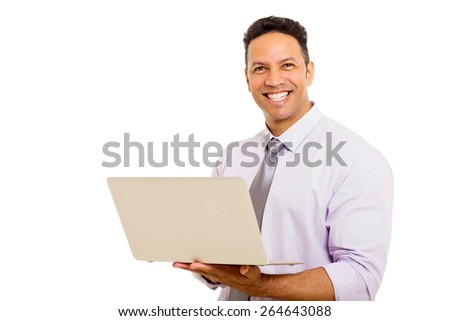 portrait of mid age man using laptop computer - stock photo
