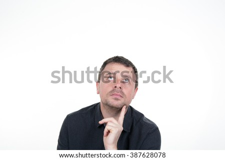 Portrait of mid aged  man looking up - isolated on white.