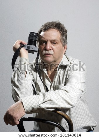 Portrait of middle age and handsome professional photographer