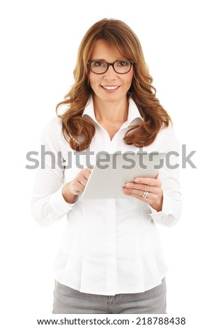 Portrait of middle age businesswoman touching digital tablet against white background.  - stock photo