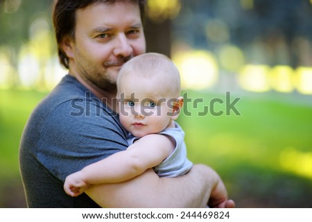 Portrait of middle age father with his little son - stock photo