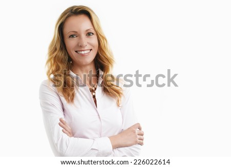 Portrait of middle age woman standing against white background. - stock photo
