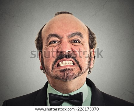 portrait of middle aged angry man - stock photo