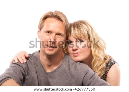 Portrait of middle aged couple on white background. - stock photo