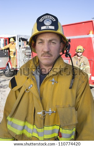 Portrait of middle aged firefighter - stock photo