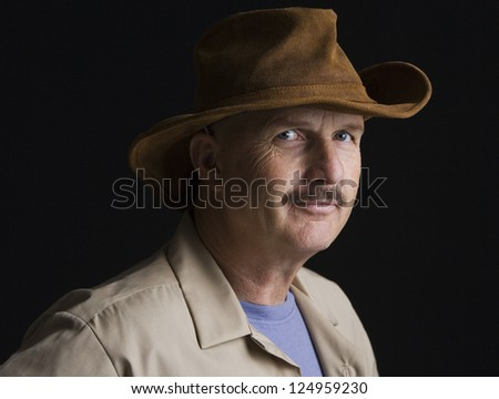 Portrait of middle aged man in hat