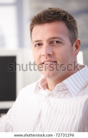 Portrait of middle-aged office worker smiling in office.? - stock photo