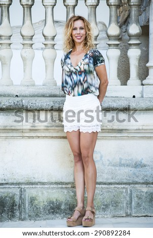Portrait of middle aged  pretty woman  on the outside of a museum - stock photo