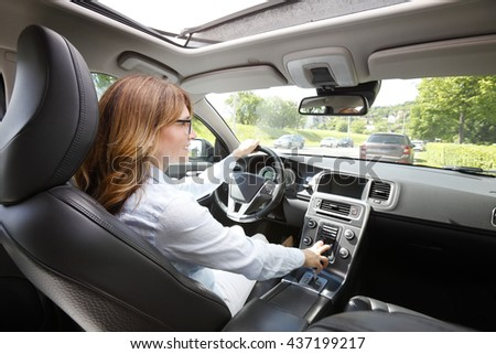 Portrait of middle aged woman driving a car.