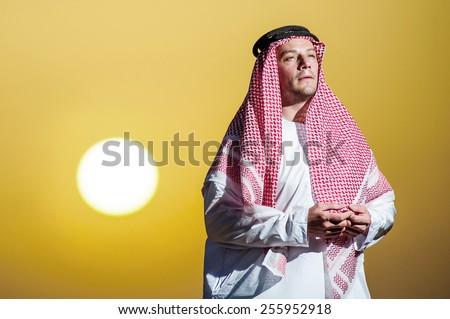 Portrait of Middle Eastern arab man in the desert. - stock photo