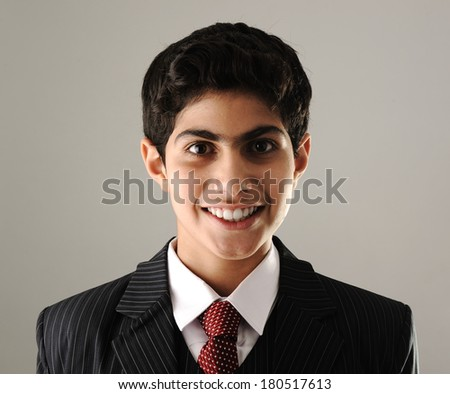 Portrait of Middle eastern boy wearing suit and tie