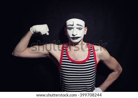 Portrait of mime actor on black background