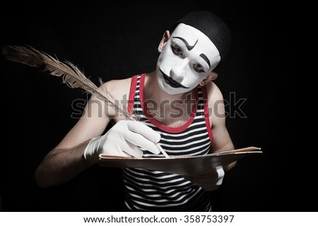 Portrait of  mime with  quill on black background