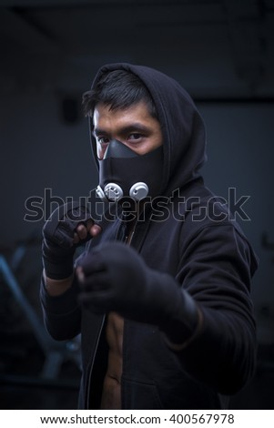 portrait of mma fighter wearing training mask - stock photo