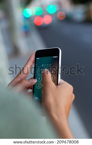 Portrait of mobile phone in a woman's hand in the city at night. - stock photo