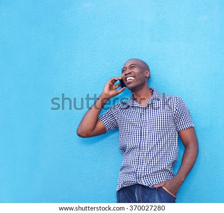 Portrait of modern african man talking on cell phone  - stock photo