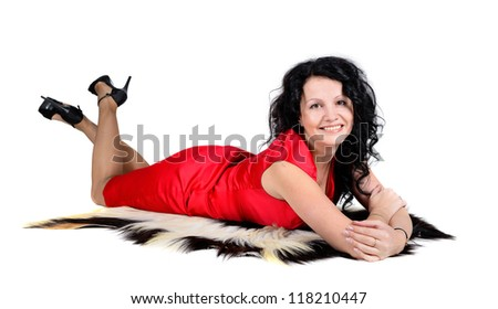 portrait of modern attractive caucasian smiling woman brunette isolated on white studio shot lieng on the fur rug.